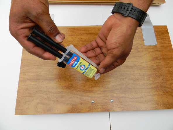 This is a 5 minute  quick setting 2 part wood epoxy. Take the top off the epoxy.  Connect the syringe tip and lock it in place. Press the plunger so you can fill the needle tip with epoxy.