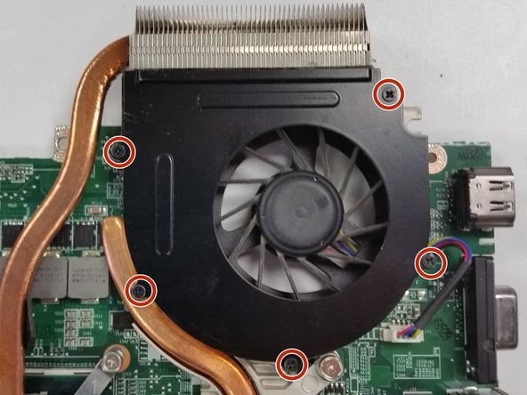 Remove the 5 black screws around the edge of the fan.