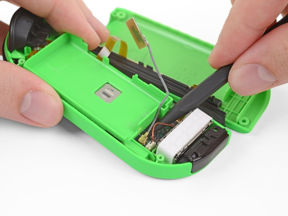 Pry up with the pointy end of a spudger to disconnect the antenna cable's coaxial connector from the motherboard.