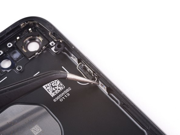 Pull the clip towards the bottom of the phone and lift up to free it from the bracket.