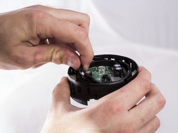 Now grasp the plastic on the outside of the rubber seal and pull it out by applying an upward force.