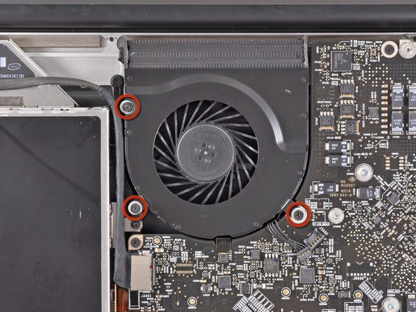 Remove the three 3.1 mm Phillips screws securing the right fan to the logic board.