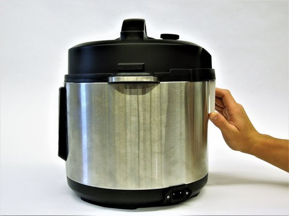 Locate the condensation collector on the back of the pot, opposite of the LED Display.