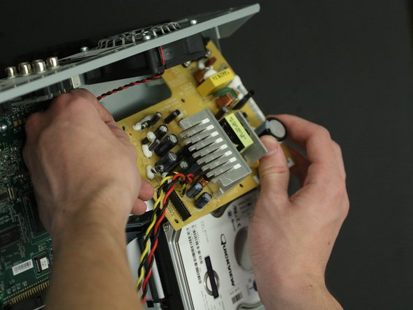 Lift the power supply out of the unit.