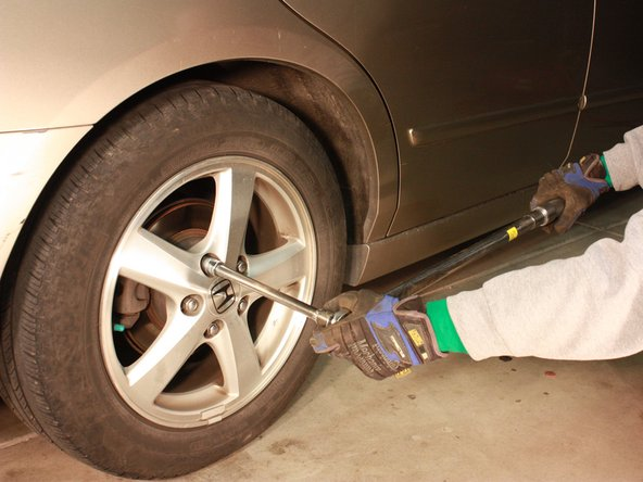 Using a torque wrench, tighten the lug nuts on each wheel to the car manufacturer's recommended torque specification found in the user's manual.