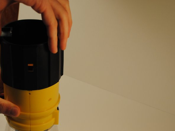 Slide the black rubber sleeve off of the outside of the body of the lantern away from the LED globe.