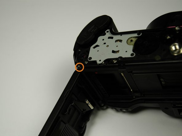 From the bottom of the camera push the hinge rod in with your finger.
