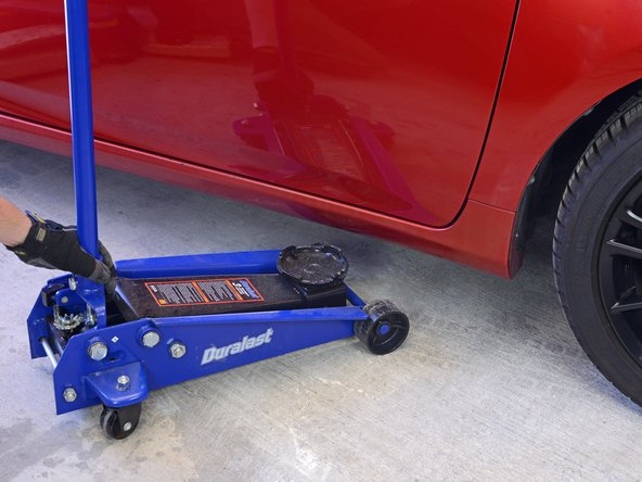 Slide the jack under your vehicle in the area of the jack point that you have chosen.