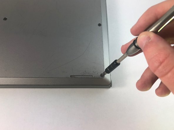 Remove the nine 7.6mm PH0 screws on the cover.