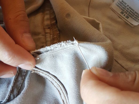 Pin needle and thread through pants.