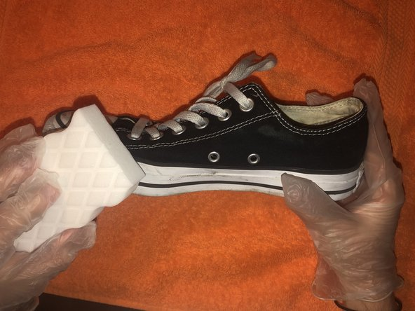 Clean off Converse Sneaker with Mr. Clean magic eraser.