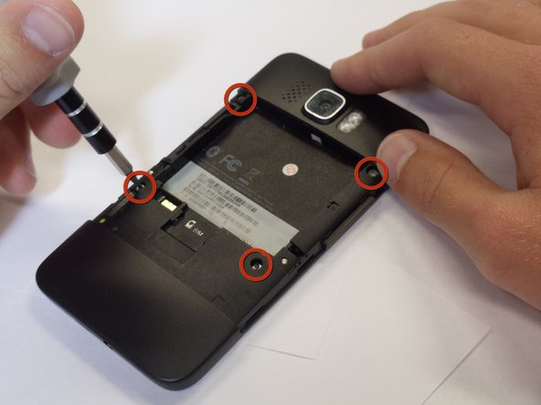 Remove the four black 3.5mm T5 screws from the back of the phone.