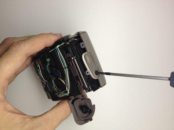Remove the film door lever.
