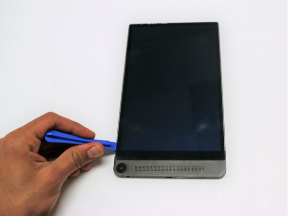 With a plastic opening tool, pry open the bottom left corner of the screen.