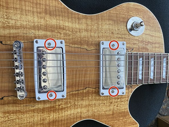 Screw back on the control cavity cover and flip over your guitar.