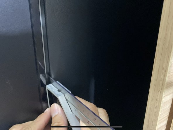 Measure the depth of the magnetic strip along the door trim.