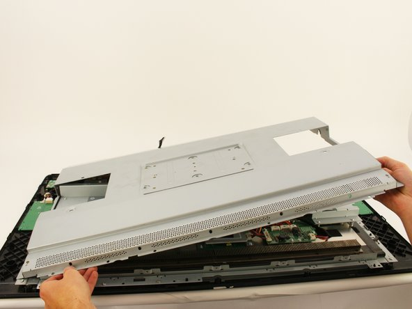 Remove the back metal plate by lifting up along one edge , then lifting the plate off and away from the device.