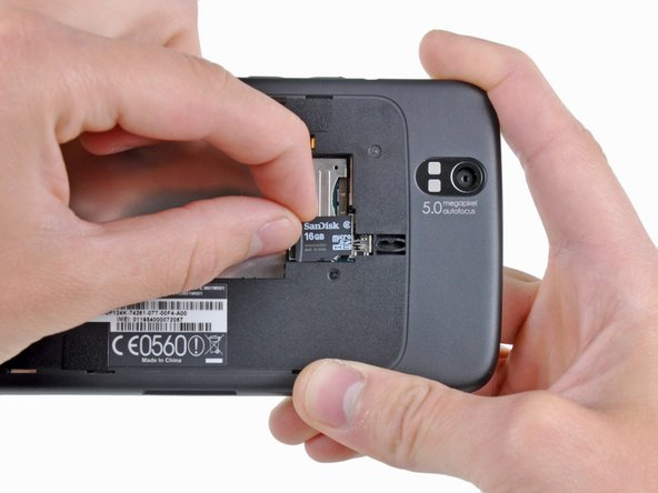 After the battery is removed, the pre-installed 16 GB microSD card can be slid out of its socket.