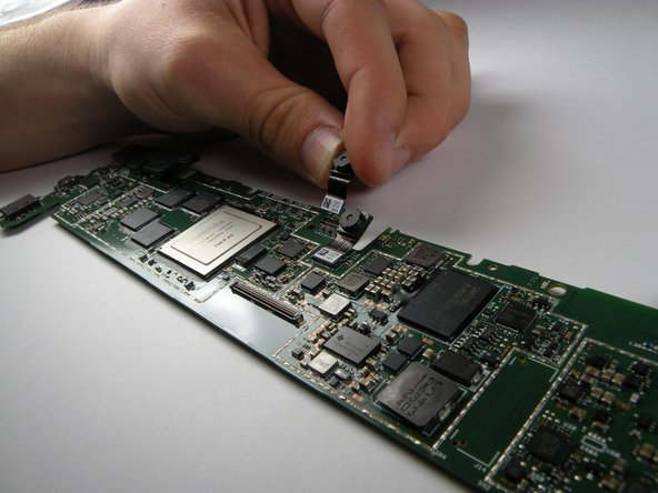 Avoid touching the lens of the camera and unplug it from the bottom of the motherboard.