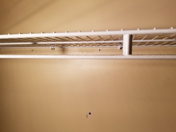 Take the closet rack and place it onto the brackets.