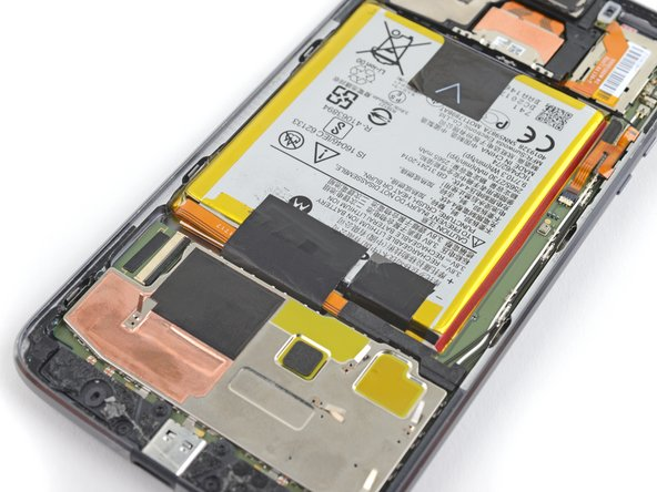Use a pair of tweezers to remove the two black pieces of tape securing the battery.