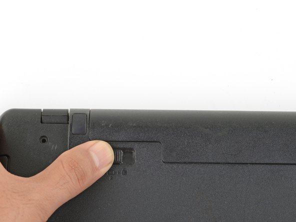 Use your finger to slide and hold the left latch outwards in the unlock position.