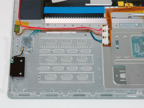 The Bluetooth board has moved from near the hard drive in the lower case, and is now mounted on the upper case near the new Firewire port on the right side.
