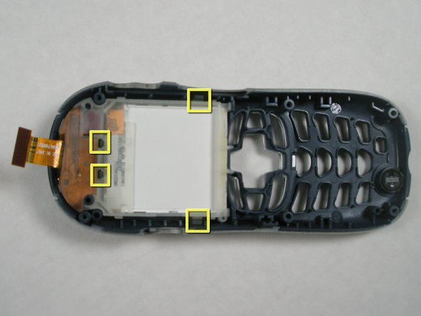 To remove the LCD screen, you will have to first release the 4 tabs that hold the screen in place.