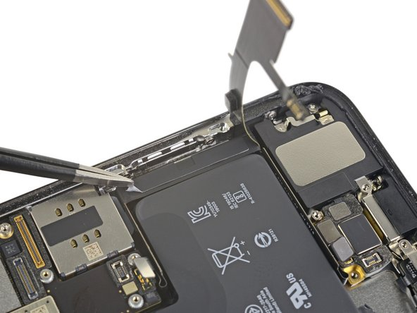 Peel up the two remaining battery adhesive pull-tabs to un-stick them from the right edge of the battery.
