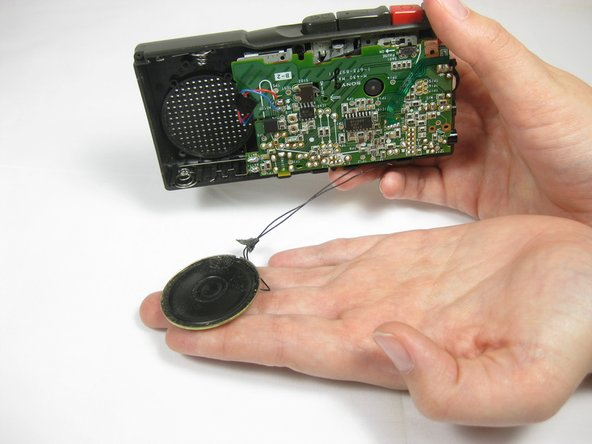 Now that the speaker is detached from the device, simply tilt the device over and let the speaker fall out.