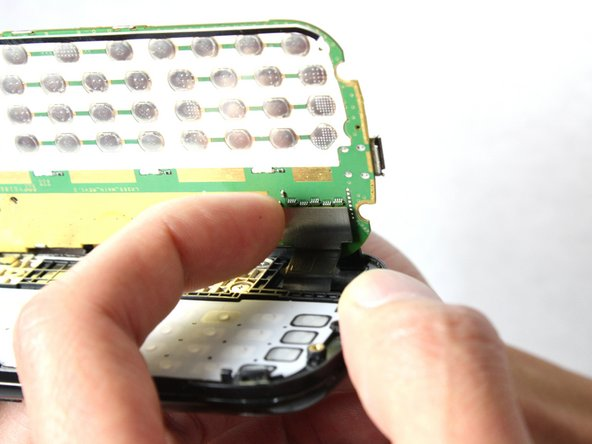 Use your finger to pull the flex cable out from its connector.