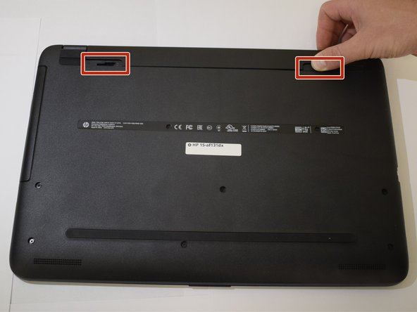 Turn the computer upside down on a level surface.