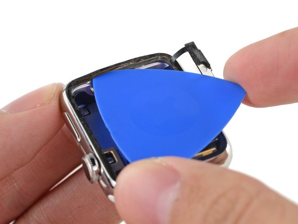 Use a plastic opening pick and tweezers to remove the Force Touch sensor from the case.