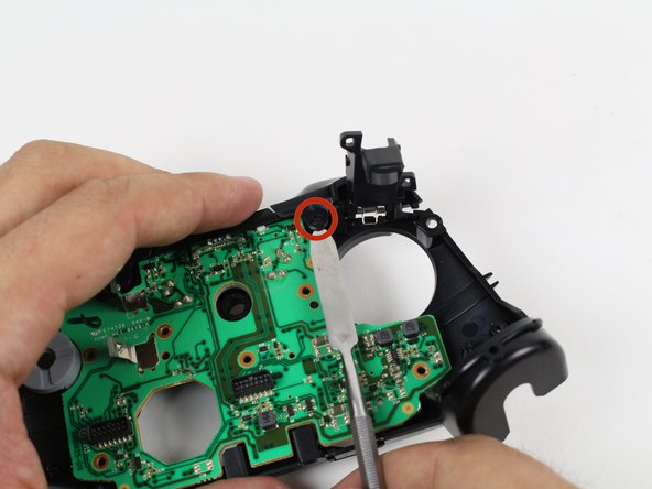 Remove the bumpers by prying them off of the pegs that secure them, using a spudger.  They are located on the front and back of the controller.