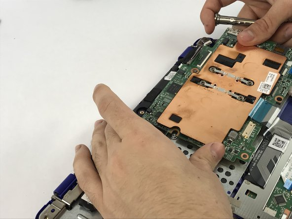 Lift the mother board off the palm rest and keyboard assembly.