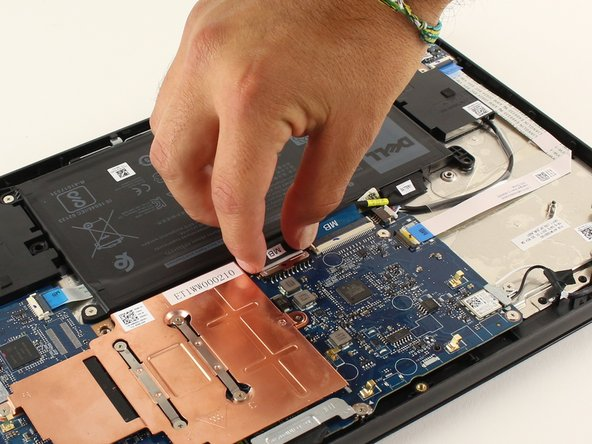 Unplug the battery from the motherboard by gently pulling the black cable header from the motherboard towards the battery.
