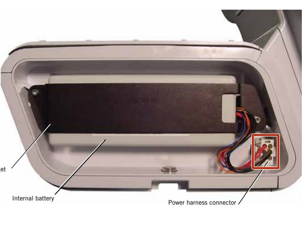 Disconnect the internal battery from the power harness connector.