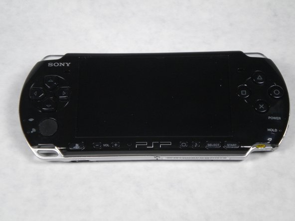 The first picture is a view of the front of the PSP-3000. The second picture is of the back.