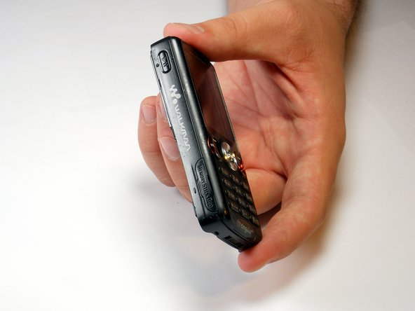 Turn the phone over and open the memory stick compartment.