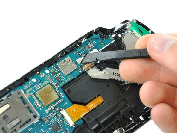 Using the flat edge of a spudger, pry the wireless board cable connector straight up and off the motherboard.