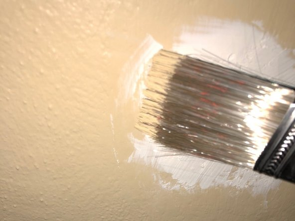 Paint over the surface with a paint brush.