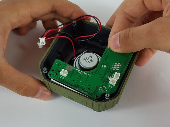 Carefully remove the motherboard with your hand by lifting it from the device.