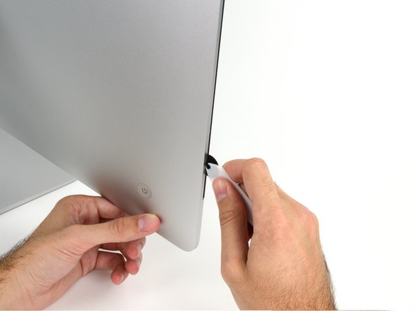 Use the tool like a pizza cutter—roll it along through the gap, and it will cut the foam adhesive through the center.