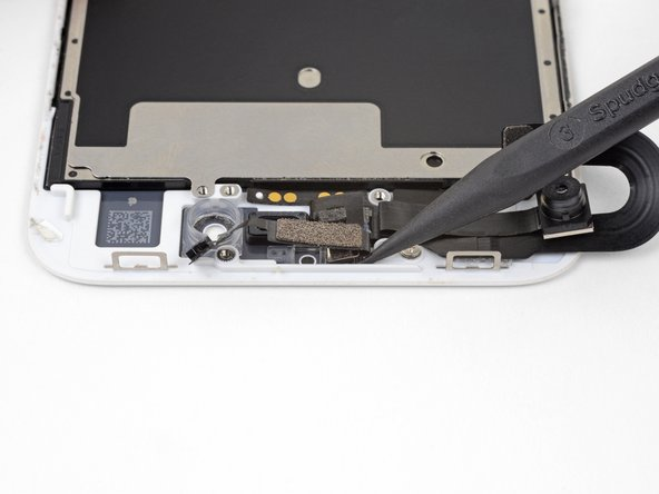 Slide the tip of a spudger underneath the ambient light sensor flex cable, and lift the sensor out of its housing.