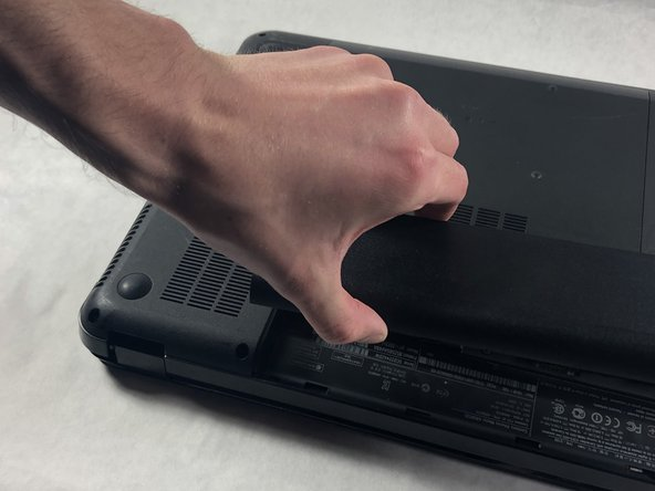 Use your thumb to pry up the edge of the battery and lift it out of the device.