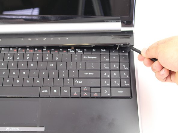 Flip the Device so the keyboard and display screen are faced upright.
