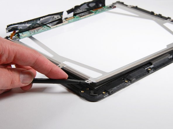 The display seems to be glued around its perimeter but can still be removed from the plastic framework.