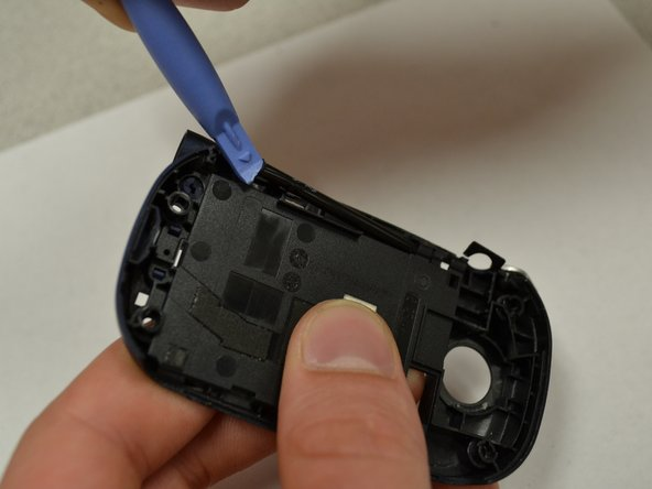 Using a plastic opening tool, lift and remove the antenna casing.