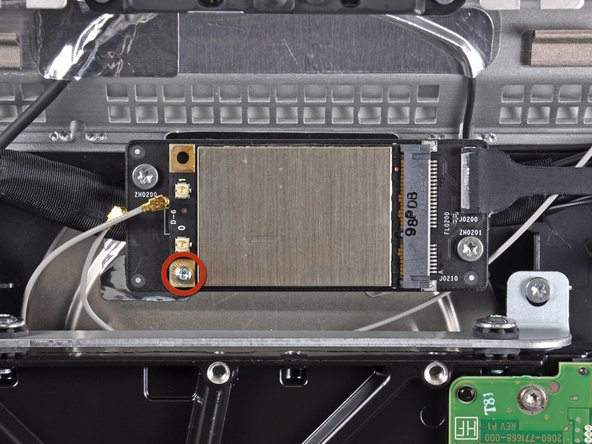 Remove the single 5.3 mm T6 Torx screw securing the AirPort card to its socket.