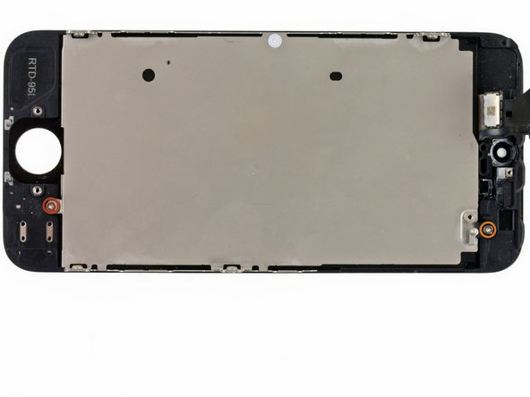Remove the two screws securing the LCD shield plate to the display assembly: